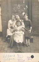 Four girls sitting on wooden stoop, Philadelphia.