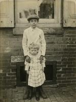 Boy and girl standing in front of window, Philadelphia.