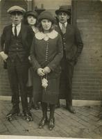 Two teenage men and two teenage women standing in front of window, Philadelphia.