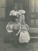 Three women and two men on a wooden stoop, Philadelphia.