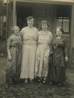 Four older women standing in grassy backyard, Philadelphia.