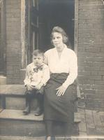 Woman with boy sitting on stoop, Philadelphia.