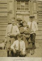 Five boys posing in front of wooden house, Philadelphia.