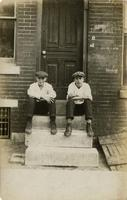 Two young men sitting on marble steps, Philadelphia.