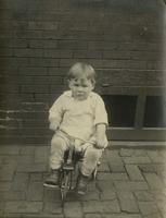 Little boy riding a small tricycle, Philadelphia.