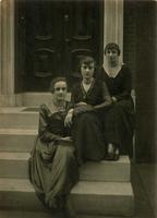 Three women sitting on marble steps, Philadelphia.