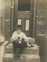Boy and his dog sitting on marble steps, Philadelphia.