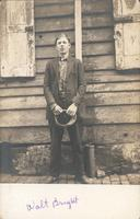 Young man standing in front of wooden house, Philadelphia.