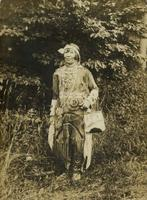Native American woman standing in wooded area, Philadelphia.
