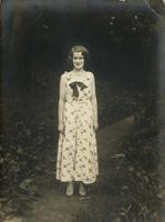 Young woman standing on woodland path, Philadelphia.
