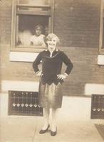 Young woman standing in front of window, Philadelphia.