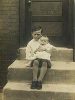 Boy with baby on old marble steps, Philadelphia.