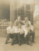 Five young men sitting outside a corner grocery store, Philadelphia.