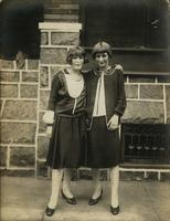 Two women standing in front of stone porch, Philadelphia.