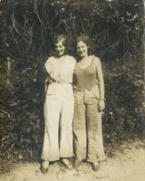 Two young women standing on dirt path, Philadelphia.