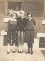 Three young women standing in front of window, Philadelphia.