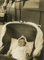 Infant in baby carriage with netting, Philadelphia.