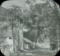 [Road beside old mill building.]