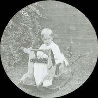 [Karl Doering as a young child, sitting in the backyard of the family residence, 1837 N. Bouvier Street, Philadelphia.]