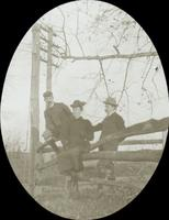 [Outing in the country, siblings of William Doering sitting on fence.]