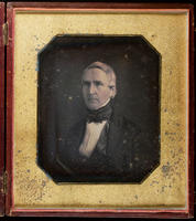 [Portrait of seated unidentified man.]