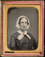 [Portrait of a rather stern, unidentified, older woman wearing a lace collar and cap.]